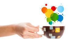 Coffee-mug with colorful abstract speech bubble Royalty Free Stock Photos