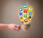Coffee mug with colorful media icons Stock Image
