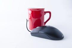 COFFEE MUG AND COMPUTER MOUSE Stock Image