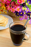 A coffee mug and crackers Royalty Free Stock Photo