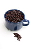 Coffee Mug Full of Beans. Blue coffee mug full of coffee beans Stock Images