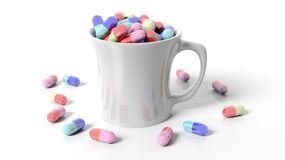 Coffee mug full of pills Royalty Free Stock Images
