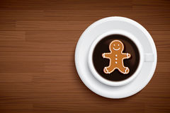 Coffee mug with gingerbread man shape on brown wood table. Vector coffee mug with gingerbread man shape on brown wood table royalty free illustration