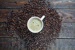 Coffee mug with grains on dark wood background. Top view Stock Photo