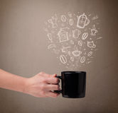 Coffee mug with hand drawn kitchen accessories Stock Photo