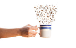 Coffee-mug with hand drawn media icons Royalty Free Stock Photography