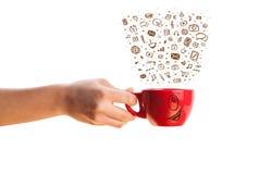 Coffee-mug with hand drawn media icons Stock Photos