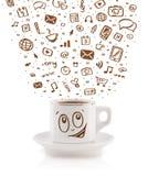 Coffee-mug with hand drawn media icons Royalty Free Stock Image