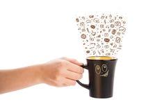 Coffee-mug with hand drawn media icons Royalty Free Stock Photos