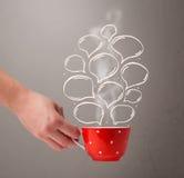 Coffee mug with hand drawn speech bubbles Stock Image