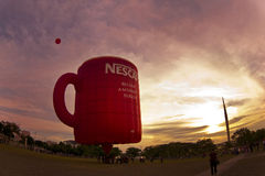 Coffee mug hot air balloon. Putrajaya, MALAYSIA - 19 March: Coffee mug hot air balloon at the First Putrajaya Hot Air Balloon Fiesta 2009. 19 March 2009 in Royalty Free Stock Image