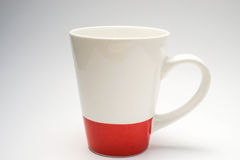 Coffee mug. Isolated white and red coffee cup with white background Royalty Free Stock Photography