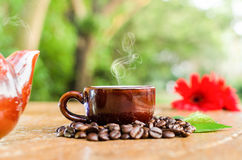 Coffee in a mug & Kettle. Coffee in a mug & Kettle with beans flower and leaves Stock Photography