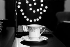 Coffee Mug and Laptop in Retro Style Working Environment. Black And White Coffee Mug and Laptop in Retro Style Working Environment Royalty Free Stock Image