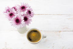 Coffee mug and lilac daisies, top view Royalty Free Stock Photo