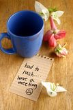Coffee mug with lipstick mark and a note Stock Images