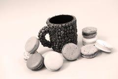 Coffee mug with macaroons Stock Image