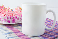Coffee mug mockup with checkered napkin. White mug mockup. Mug Product Mockup. Styled mockup. Product mockup. White cup mockup. Cup mockup. Empty Mug Mockup royalty free stock images