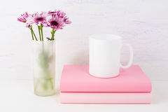 Coffee mug mockup with lilac daisy Royalty Free Stock Images