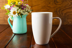Coffee mug mockup with mint green flowerpot Royalty Free Stock Photos