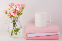 Coffee mug mockup with pink roses Stock Photo