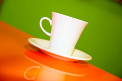 Coffee mug on the orange green Royalty Free Stock Photos