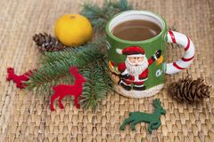 Winter coffee in a christmas mug with christmas deers Royalty Free Stock Images