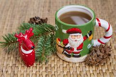Winter coffee in a christmas mug with christmas deers. Coffee mug with pine cones and deers.Christmas festivities Royalty Free Stock Photography