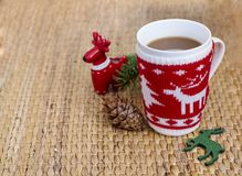 Winter coffee in a christmas mug with christmas deers. Coffee mug with pine cones and deers.Christmas festivities Royalty Free Stock Photos