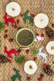 Winter Coffee in a Christmas Mug with Christmas Deers. Coffee mug with pine cones and deers.Christmas festivities Stock Images