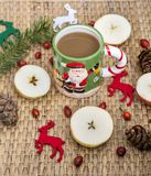 Winter Coffee in a Christmas Mug with Christmas Deers. Coffee mug with pine cones and deers.Christmas festivities Stock Photography