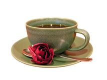 Coffee mug with rose. Green coffee cup and artificial rose with white background stock photo