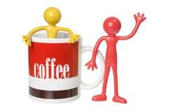 Coffee Mug and Rubber Figures Stock Photos