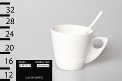 Coffee mug shot. A mug shot of a dangerous cup of coffee Stock Images