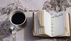 Coffee mug and notebook Royalty Free Stock Image