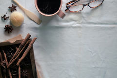 Coffee mug and spices on white Tablecloth. Stock Image