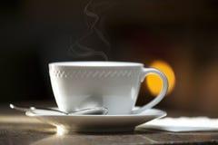 Coffee Mug with Steam and Saucer Stock Photo