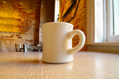 Coffee mug and table Royalty Free Stock Image