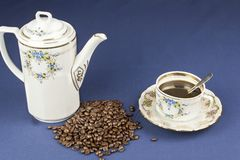 Coffee mug on the table with a blue tablecloth Royalty Free Stock Photo