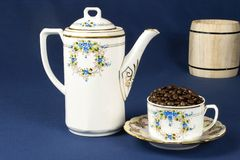 Coffee mug on the table with a blue tablecloth Stock Photos
