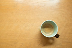Coffee mug on table Royalty Free Stock Images