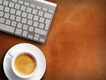 Coffee mug on the table with a keyboard Stock Photo