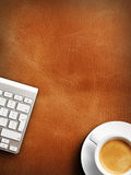 Coffee mug on the table with a keyboard Royalty Free Stock Image