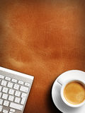 Coffee mug on the table with a keyboard Stock Photography