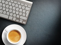 Coffee mug on the table with a keyboard Stock Images