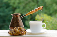 Coffee Mug, two cookies and copper Cezve on the desk of street cafes Stock Photography