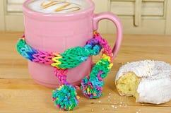 Coffee mug with warm scarf Royalty Free Stock Photo
