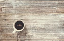 Coffee mug on a wooden desk Stock Photography