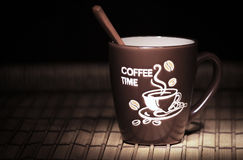 Coffee mug with wooden spoon Royalty Free Stock Images
