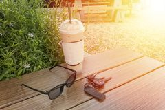 Coffee mug on wooden table with glasses and car keys Royalty Free Stock Photography